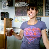 At the Blue Canary Coffeehouse in Harmony, barista Kim Fabrizio holds a nitro coffee, dispensed from a keg with nitrogen.