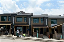 Exterior of townhouses being built by a.m. Rodriguez Associates.