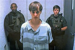 Dylann Roof appears via video before a judge in Charleston, S.C., on June 19.