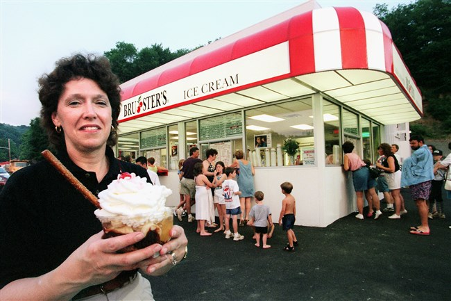 At Bruster's Ice Cream in Ross, co-owner Carolyn Cimato holds an ice cream treat while customers order at the windows.The store opened June 3 and is the newest store for the 10 year old chain that has 35 stores in seven states. shot  6/10/99  Original Filename: mendelsohn bus brusters c.jpg  company spotlight