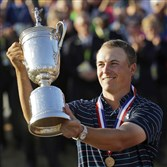 Jordan Spieth holds up the trophy after winning the 2015 U.S. Open Chambers Bay in University Place, Wash. He will play a practice round at Oakmont on Wednesday.