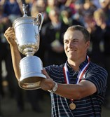 Jordan Spieth holds up the trophy after winning the U.S. Open golf tournament Sunday at Chambers Bay in University Place, Wash.