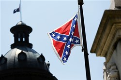 The South Carolina law that allows the Confederate battle flag to fly on the State House grounds came under intense scrutiny after the June 17 attack on the church.