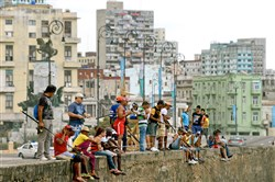 Fishermen of the Malecon gather on the sea wall, chasing schools of Chopa.