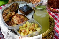 Traditional Picnic Basket filled with fried chicken, herbed potato salad, lemonade and chocolate sheet cake.