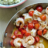 Garlicky shrimp are paired with sweet cherry tomatoes in this light summer dish.