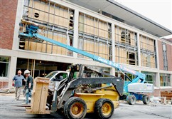 Workers with Specified Systems prepare for the installation of new curtain wall windows, called SageGlass, on Thursday to improve energy efficiency and maximize natural light in the soon-to-be Carlow University Commons, formerly Grace Library.