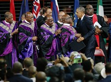 President Barack Obama is greeted as he prepares to deliver the eulogy for South Carolina state Sen. and the Rev. Clementa Pinckney during Rev. Pinckney's funeral service Friday in Charleston, S.C.