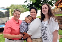 Deb Whitewood, left, son Landon, 4, her partner Susan Whitewood, and daughter, Katie, 16, right.