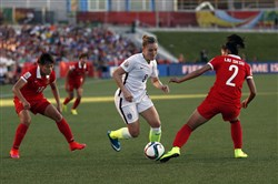 U.S. forward Amy Rodriguez dribbles against China defender Liu Shanshan in the World Cup quarterfinals.