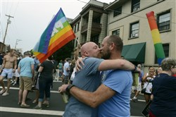 Steve Clark, left and Scott Smith who married 7 years ago in Massachusetts., joined about 700 people gathered in Shadyside at Ellsworth and Maryland Avenue early Friday evening for a rally celebrating the U.S. Supreme Court ruling there is a constitutional right to same-sex marriage in all 50 states.