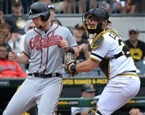 Pirates catcher Francisco Cervelli tags out the Braves' Chris Johnson at PNC Park.