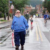 Bruce Szwaczkowski take advantage of the open streets to walk down Butler Street in Lawrenceville during OpenStreetsPittsburgh in 2015.