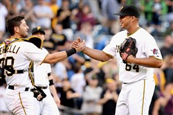 Pirates pitcher Deolis Guerra is congratulated by catcher Francisco Cervelli after a win against the Braves over the weekend at PNC Park.