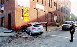 Pittsburgh police block off a section of Penn Avenue after an SUV crashed into a building overnight, injuring five teens.