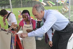 After speaking about childhood hunger and the Grub Up program at Cowley Park in Troy Hill, U.S, Sen. Bob Casey, right, took some time to look at what the children were doing with the Roving Art Cart programs. Here he talks with Pittsburgh resident Jiannah Hood, 8.
