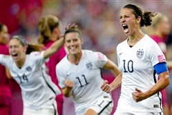 United States' Carli Lloyd (10) celebrates with teammates Ali Krieger (11) and Morgan Brian after scoring on a penalty kick against Germany during the second half of a semifinal in the Women's World Cup soccer tournament on June 30. It's USA vs. Japan at 7 p.m. Sunday in the finals.