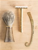Brass and badger shave brush ($140), silver and brass handmade safety razor ($398) and hand-forged mustache comb ($65) by Studebaker Metals (www.studebakermetals.com).