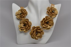 Gilded rose necklace by Nicolette Jewelry Sculptures, $269 at www.nicolettejewelrysculptures.com.
