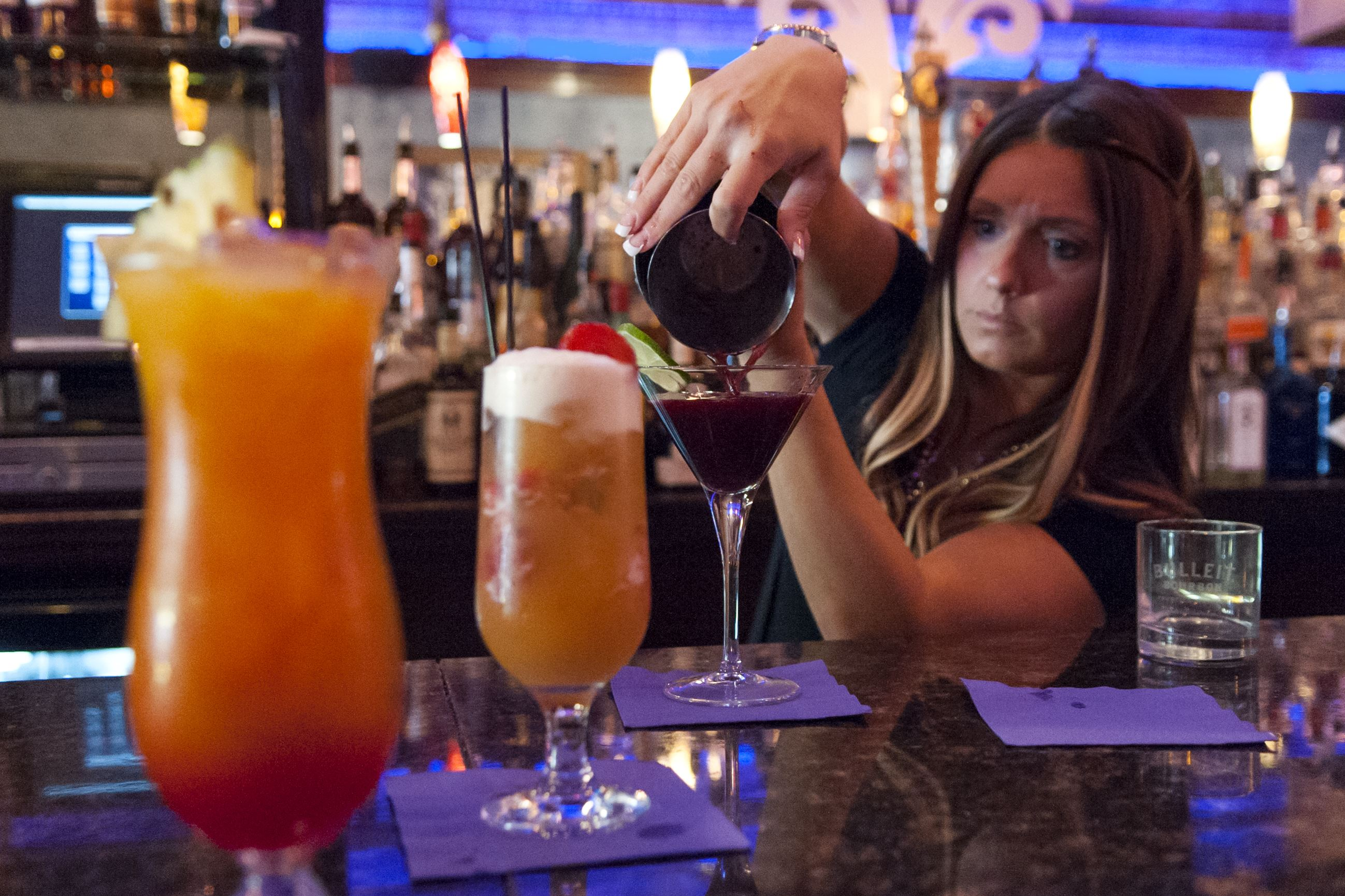 20150630amfNOLAbarguide2015075-5 Dana Monica of Mount Washington pours a drink at NOLA on the Square.