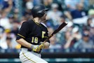 Pirates second baseman Neil Walker hits a two-run double in the ninth inning against the Tigers at Comerica Park.