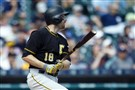 Pirates second baseman Neil Walker hits a two run double in the ninth inning Thursday against the Detroit Tigers at Comerica Park.