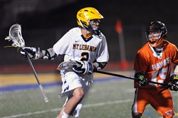 Mt. Lebanon's Dan Lee, left, looking to score around Bethel Park's Rob McMahon, made a significant contribution to the Pennsylvania team at the Brine National Lacrosse Classic.