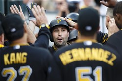 Pirates second baseman Neil Walker receives congratulations from teammates after he hit a two-run home run in the third inning Wednesday against the Detroit Tigers at Comerica Park.