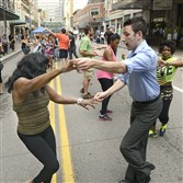 Instructor Brandon Perpichof the Arthur Murray Dance Studio coaches Karen Lindsey on Penn Avenue during Open Streets Pittsburgh last year.