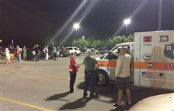 Emergency personnel stand by as evacuees gather at the Foothills Mall early today in Maryville, Tenn., after they were forced to leave their homes when a rail car carrying a flammable and toxic gas derailed and caught fire.