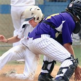 Swissvale's Tyler Babyok slides safely into home as Plum catcher Dante Palmieri waits for the throw in American Legion baseball action last month.