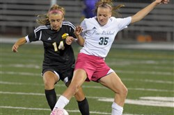 Pine-Richland's Amanda Kalin, right, battles Sarah Chomos of North Allegheny for control of the ball in a match in October. Kalin is a soccer standout who was selected the North Xtra Female Athlete of the Year.