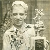 A young Doug Opperman with a marble tournament trophy.