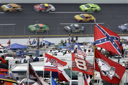 A Confederate flag flies in the infield as cars come out of Turn 1 during a 2007 NASCAR race at Talladega Superspeedway in Talladega, Ala.