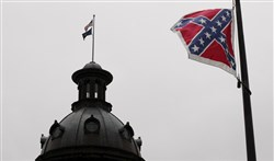 A Confederate flag flies at a confederate monument in front of the South Carolina State House in Columbia, South Carolina on July 4, 2015.