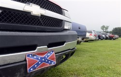 At Motordrome Speedway in Smithton, Pa.  Red white and blue had a small presence with only one Confederate Flag license plate, as a small crowd gathered waits for the rain to stop. The races were cancelled.