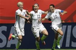 From left, United States' Megan Rapinoe, Lauren Holiday, and Carli Lloyd celebrate after Lloyd scored her second goal of the match against Japan during the first half of the FIFA Women's World Cup soccer championship in Vancouver, Sunday.