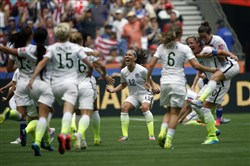 United States midfielder Lauren Holiday (12) celebrates with teammates after defeating Japan, 5-2, to win the FIFA 2015 Women's World Cup at BC Place Stadium in Vancouver.
