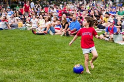 Avielle Keller, 6, of Squirrel Hill, plays soccer while she watches the United States Women's National Soccer Team play Japan at a watch party hosted by the City of Pittsburgh at Schenley Plaza on Sunday.