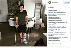 "In this image released Monday July 6, 2015 by world number one golfer Rory Mcilroy shows him as he poses on crutches and with his left leg in a medical support. McIlroy  ruptured a ligament in his left ankle while playing soccer less than two weeks before the start of his British Open title defense. The Northern Irish golfer gave no indication how long he would be out in the announcement Monday July 6, 2015 on his Instagram account, only saying that he is ""working hard to get back as soon as I can."""