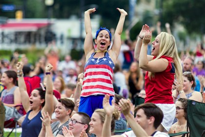 Erin Franciscus of Shadyside, left, and Megan Hill of Downtown joined the throngs cheering the United States Women's National Soccer Team to their World Cup victory Sunday over Japan.