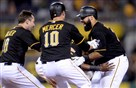 Teammates congratulate Pedro Alvarez after hitting a walk-off single to give the Pirates a 2-1 win.