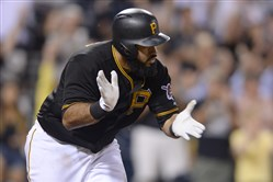 Pedro Alvarez celebrates after getting a walk-off hit over the Padres in the ninth inning Monday at PNC Park.
