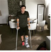 Top-ranked golfer Rory McIlroy released this image of him in a walking boot after injuring his ankle playing soccer.