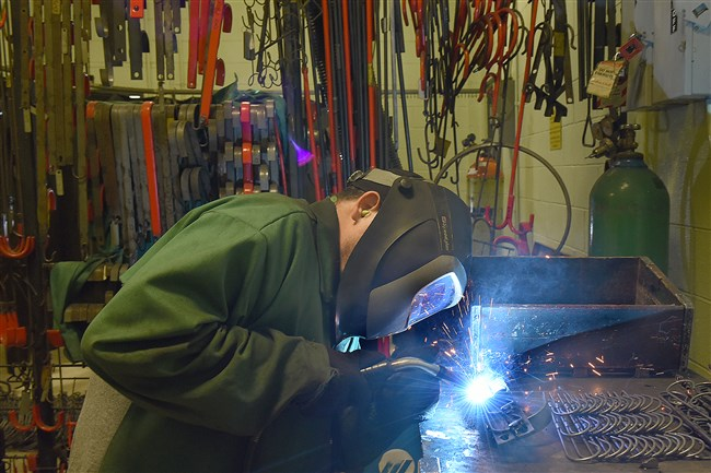 Shawn McNulty welds hook components at the Cambria County Association for the Blind and Handicapped.