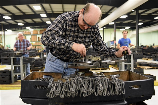 Ed Bearer bends hooks at the Cambria County Association for the Blind and Handicapped. The organization has been operating a sheltered workshop for people with disabilities for 85 years, and now offers a comprehensive array of products for mines, utilities and the solar panel industry.