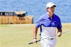 "World number one Rory McIlroy, seen here walking off the second green during the final round of the U.S. Open golf tournament on Sun., June 21, 2015 at Chambers Bay in University Place, Wash., has ruptured a ligament in his left ankle while playing soccer less than before the start of his British Open title defense. The Northern Irish golfer gave no indication how long he would be out in the announcement Monday, July 6, 2015, on his Instagram account, only saying that he is ""working hard to get back as soon as I can."""
