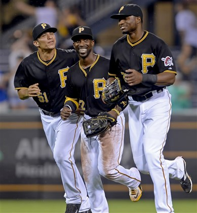 Gorkys Hernandez, Andrew McCutchen and Gregory Polanco celebrate after defeating the Padres Tuesday night.