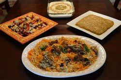 Traditional dishes prepared by Sadia Sabir (cq), Ross Twp for Eid -- the Islamic holiday marking the end of Ramadan Thursday, July 10, 2015. From center, clockwise: Chicken Biryani, Fruit Chaat, Kheer and Halwa.(Pam Panchak/Post-Gazette)