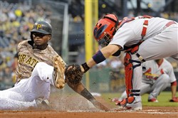 Pirates' Gregory Polanco is tagged out at home by Cardinals' Yadier Molina in the first inning of a July game at PNC Park.